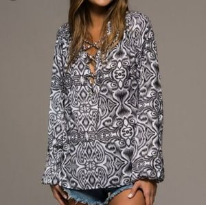 Gorgeous silky damask lace up blouse